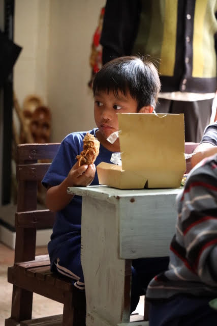 Filipino boy eating